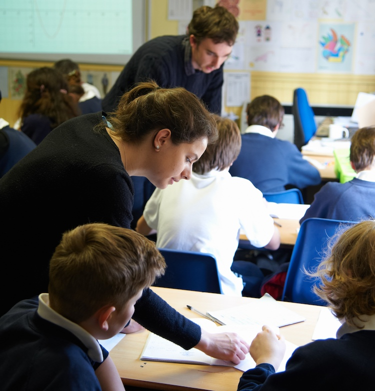 STIMULUS student volunteers helping secondary school pupils