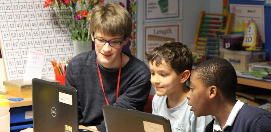 STIMULUS volunteer with primary school pupils